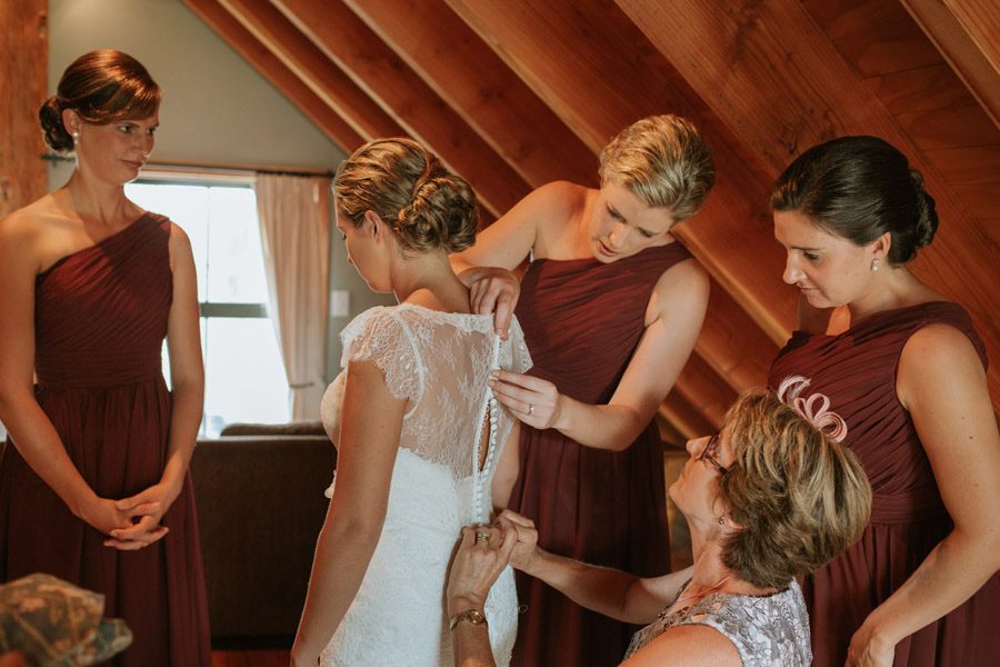 The bride getting ready with the bridesmaids from Rebecca and Matt's Lake Ohau wedding captured by Lake Ohau wedding photographers Alpine Image Company.