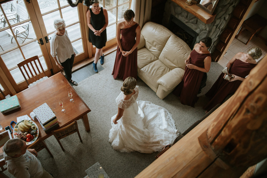 The bride with all of her bridesmaids from Rebecca and Matt's Lake Ohau wedding captured by destination wedding photographers Alpine Image Company.