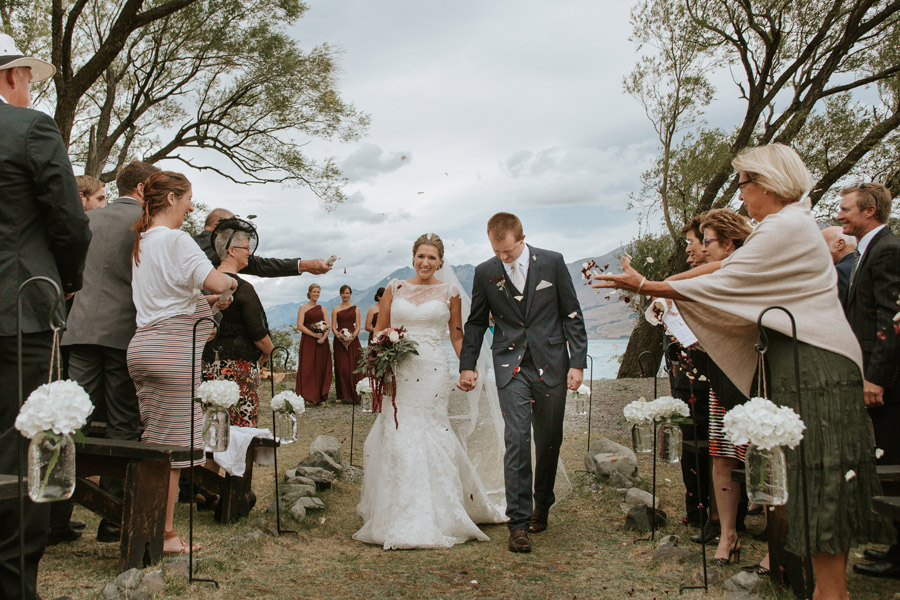 The Bride and Groom walking down the aisle after their gorgeous Lake Ohau wedding photographed by Lake Ohau wedding photographer's Alpine Image Company.
