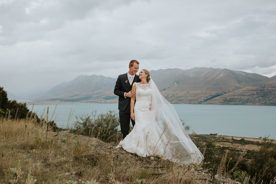 A beautiful shot of the Bride and Groom on their wedding day at Lake Ohau captured by Wanaka wedding photographers Alpine Image Company.