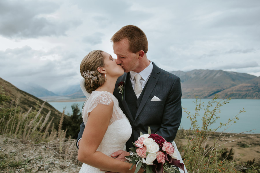 The Bride and Groom sharing a kiss on their wedding day at the Lake Ohau wedding captured by Wanaka wedding photographers Alpine Image Company.
