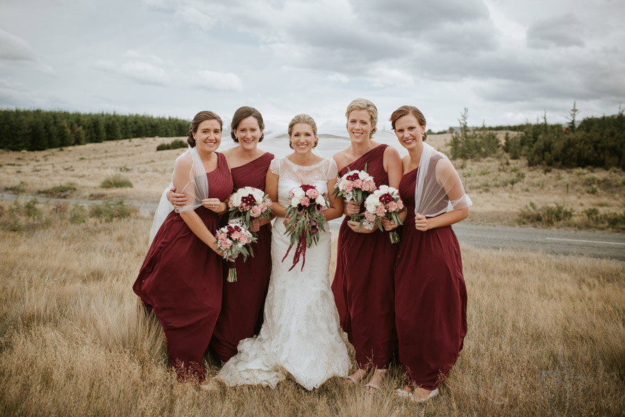 The bride and the bridesmaids looking gorgeous from this Lake Ohau destination wedding captured by Wanaka wedding photographers Alpine Image Company.