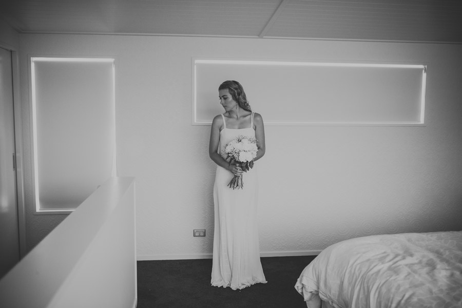 A bride waiting to leave for her wedding ceremony in Wanaka, New Zealand captured by Wanaka wedding photographers Alpine Image Company.