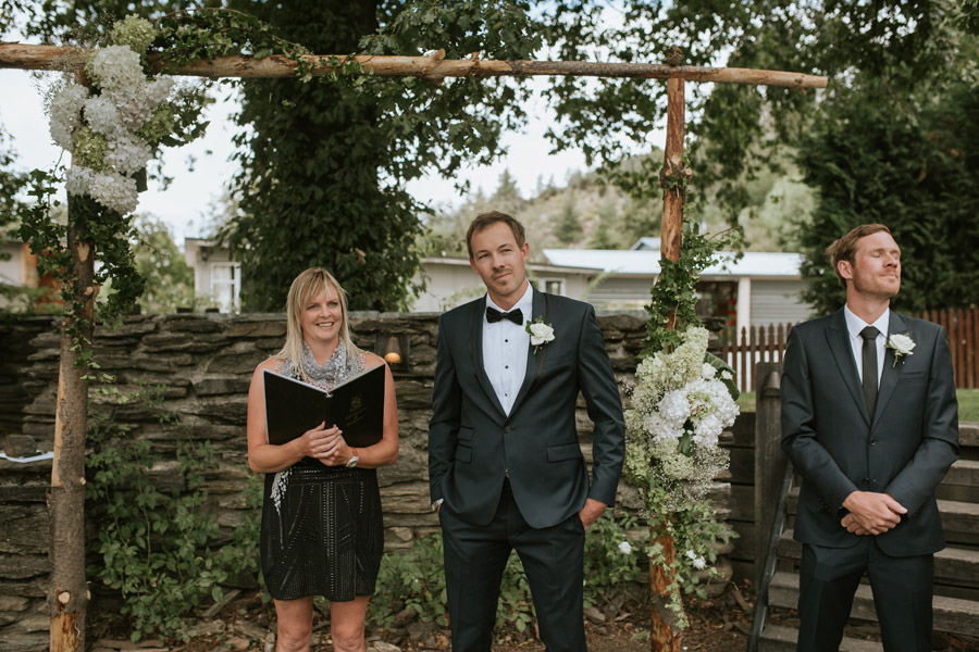 The groom anxiously waiting for his bride on his summer wedding day captured by Wanaka wedding photographer Alpine Image Company.