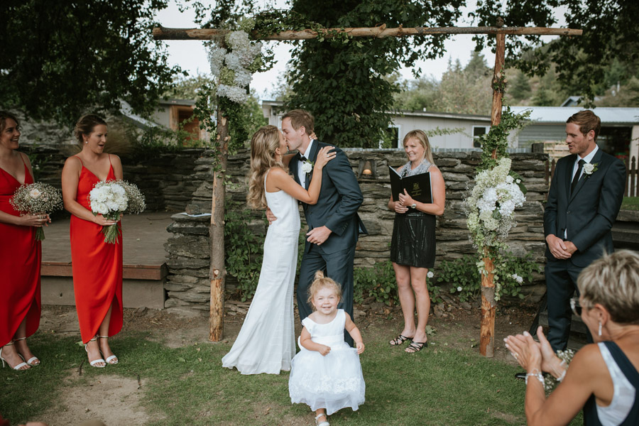 You may kiss the bride! A gorgeous moment from Kelsey and Matt's Wanaka wedding captured by Wanaka wedding photographers Alpine Image Company.