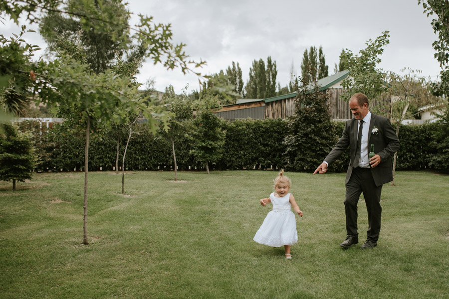 An adorable flowergirl moment from this summer wedding for Kelsey and Matt captured by Wanaka wedding photographers Alpine Image Company.