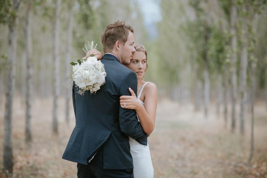 Kelsey and Matt on their beautiful summer wedding in Wanaka, New Zealand. Wanaka wedding photography by Alpine Image Company.
