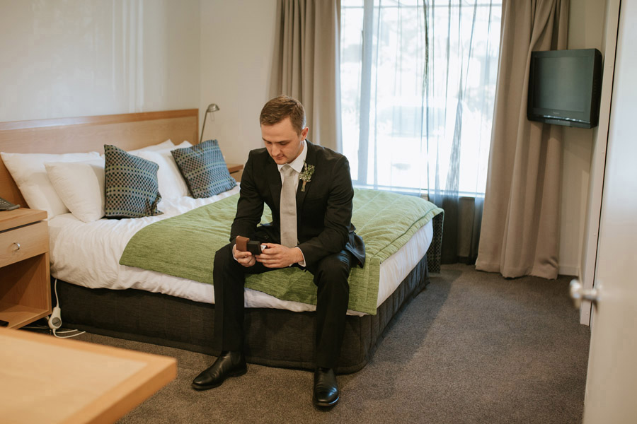 Stat, a hansome groom waiting for his bride on his Wanaka wedding day.