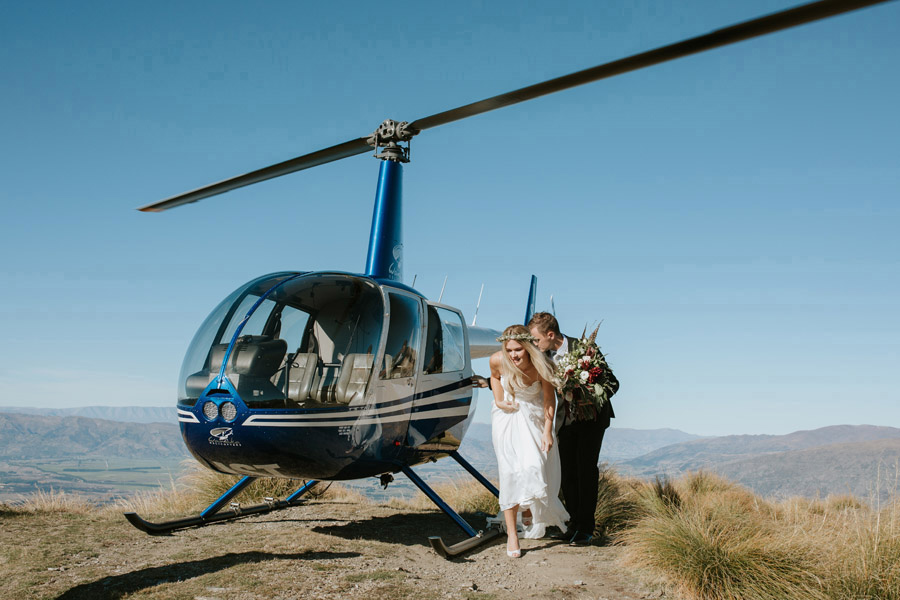 A helicopter flight is such a sleek and stylish form of transport on your Wanaka wedding day! Photography by Wanaka wedding photographers, Alpine Image Company.