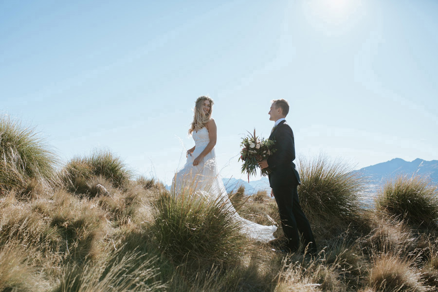 Estelle and Stas sharing a moment on Coromandel Peak, Mt Roy in Wanaka on their wedding day. Photographed by Wanaka wedding photographers Alpine Image Company.