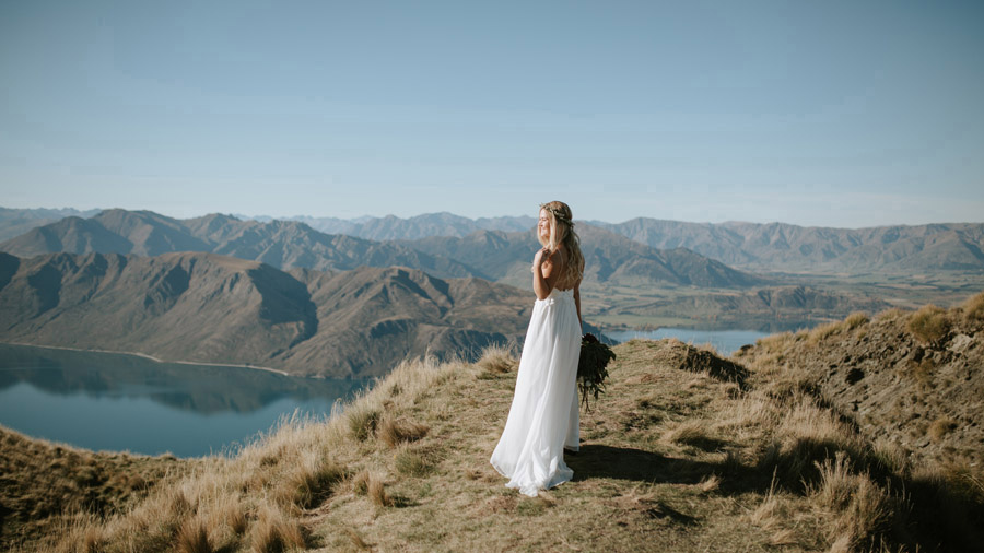 Estelle looking beautiful on top of Mt Roy, Wanaka on her autumn wedding day by Wanaka wedding photographers, Alpine Image Company.