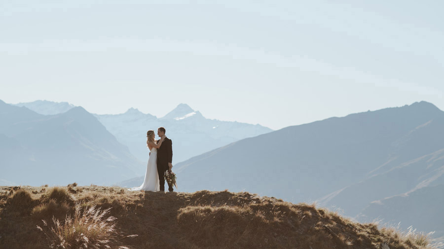 The Bride and Groom on their Wanaka wedding day on top of Mount Roy, Wanaka. Photography by Alpine Image Company.