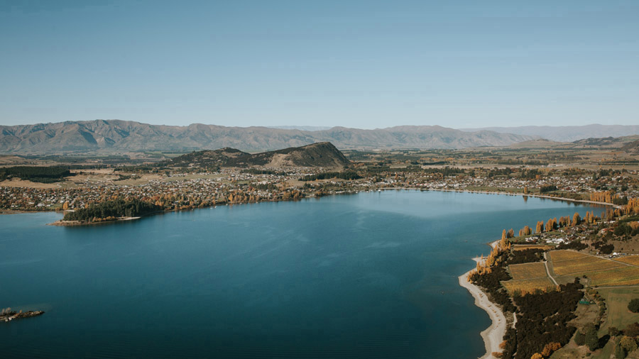 Lake Wanaka in all it's beautiful glory on an autumn wedding day. Photography by Alpine Image Company.
