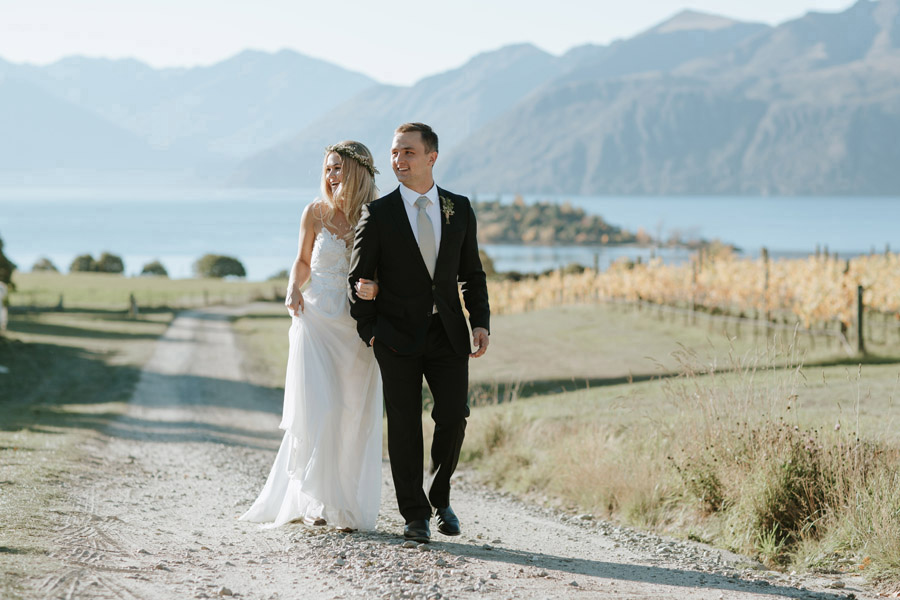 Estelle and Stas enjoying some quiet time on their Wanaka wedding day, photographed by Alpine Image Company.