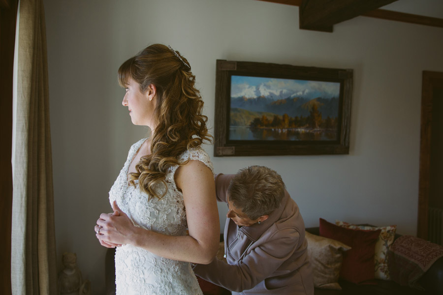 The bride getting ready on her Queenstown wedding day captured by Queenstown wedding photographers Alpine Image Company.