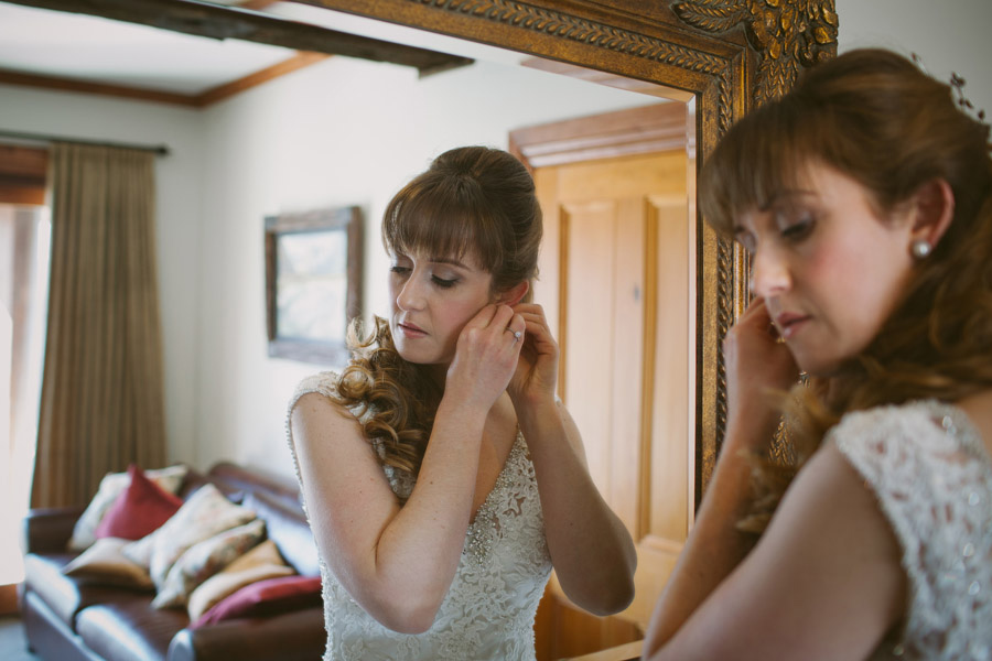 The beautiful bride, Katie, getting ready on her Queenstown wedding day. Captured by Wanaka wedding photographer Alpine Image Company.