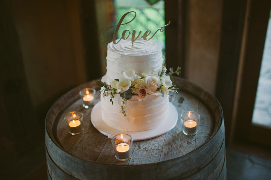 A gorgeous wedding cake and love cake topper from this Queenstown wedding at Stoneridge Estate by Wanaka wedding photographer Alpine Image Company.
