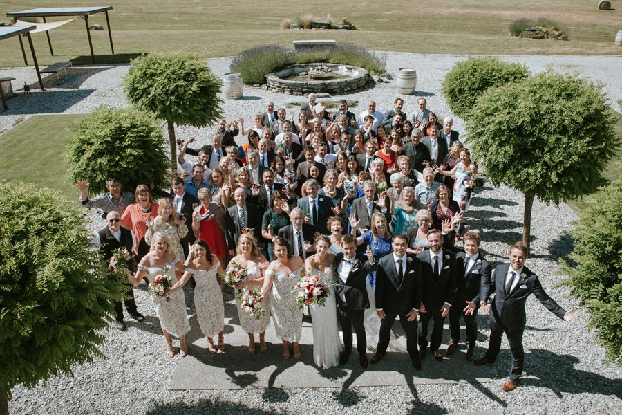 The entire wedding party looking sharp at Mt Soho Vineyard