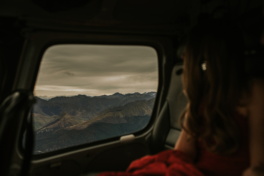 Taking a helicopter ride to a mountain top for engagement photos was the perfect celebration for Lesley and Cameron in Queenstown.
