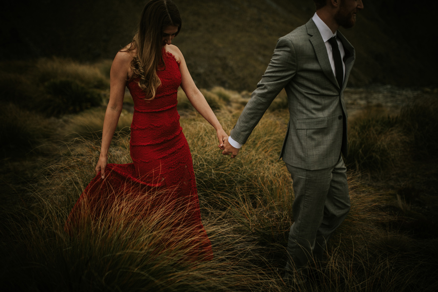 Lesley and Ash holding hands in the Queenstown Mountains on their engagement shoot