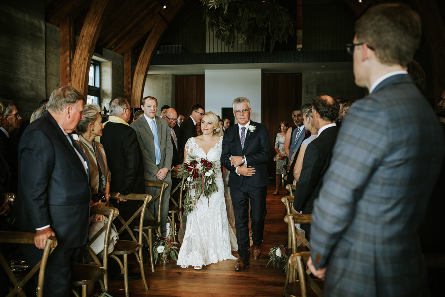 Anna and her Dad walk down the aisle at Rippon Hall. With photography by Alpine Image Company