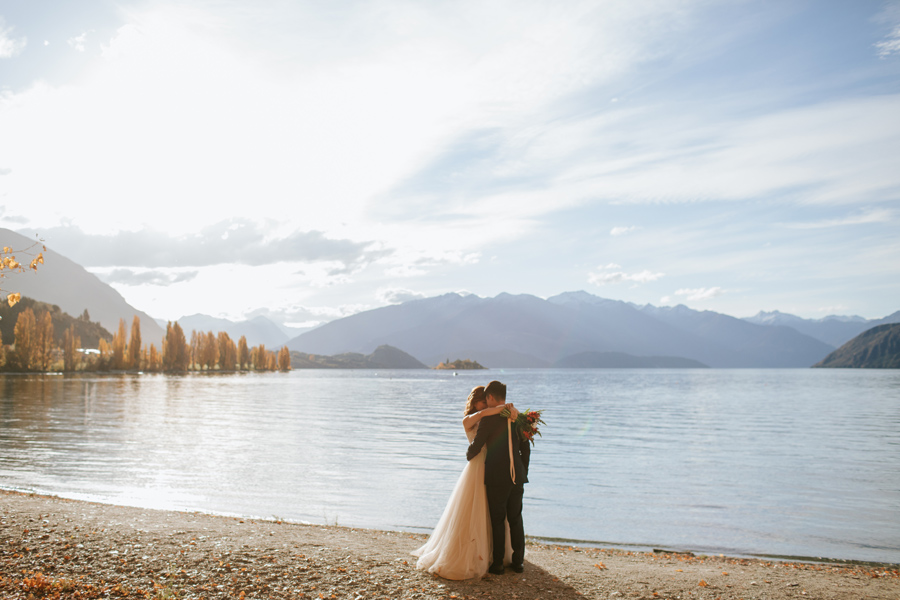 So much love between Jamie and Eric, relaxing here by Lake Wanaka, on their wedding day.