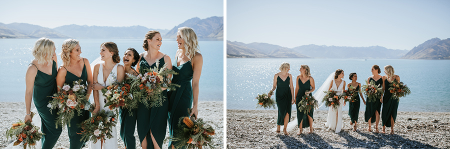 A bride and her beautiful bridesmaids laugh together. They stand infront of a beautiful, blue, glacial lake. There are mountains in the background. With photography by Alpine Image Company