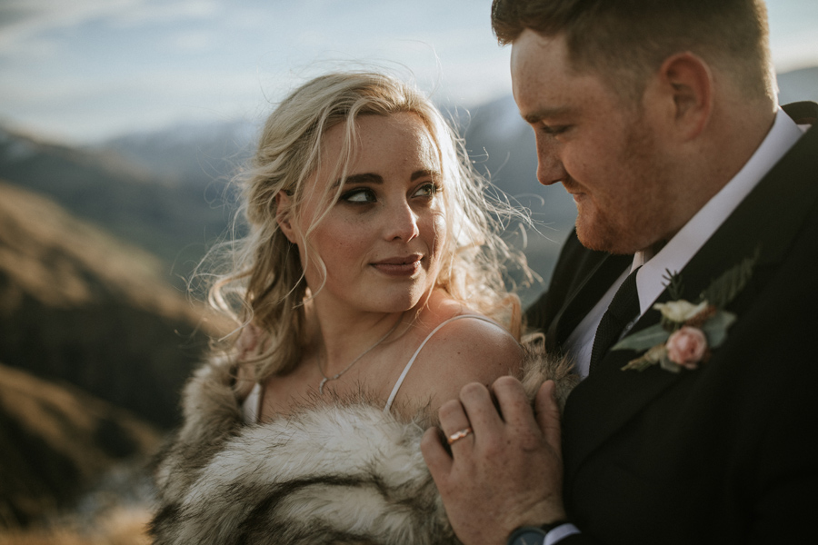 A bride gazes at her groom on their Wanaka Wedding Day. With photography by Alpine Image Company