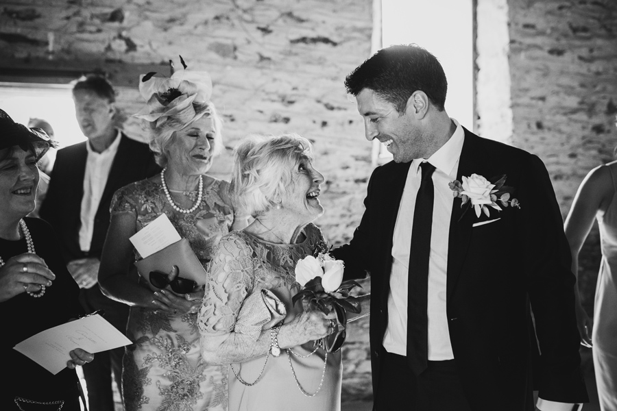 A grandmother admires her grandson on his Queenstown Wedding Day, at Peregrine Vineyard. With photography by Alpine Image Company