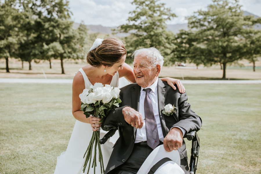 A bride and her grandfather share a moment on her Queenstown Wedding Day. With photography by Alpine Image Company